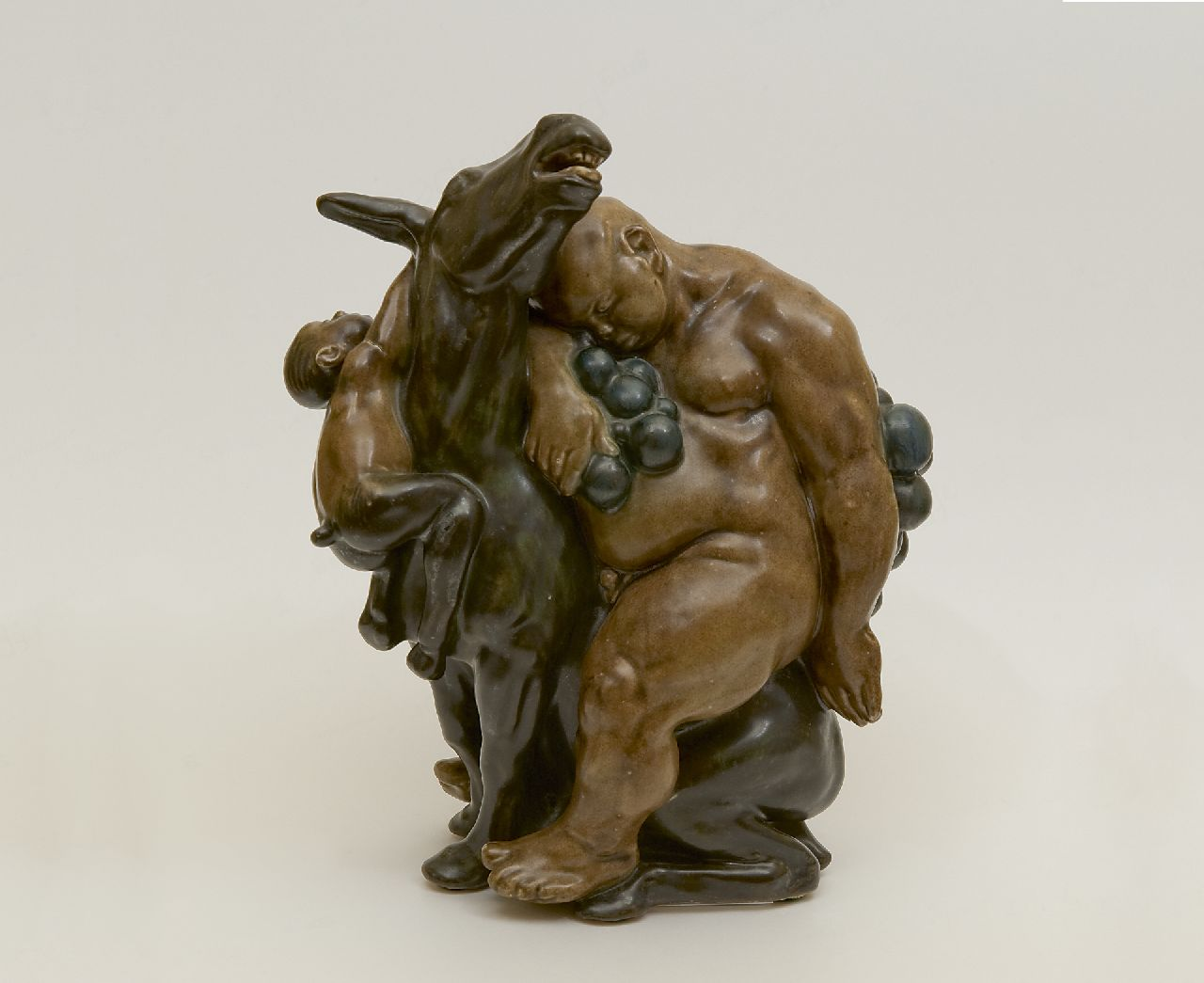Nielsen K.  | Kai Nielsen | Sculptures and objects offered for sale | Bacchus and Faun - two sculptures, polychrome painted, glazed pottery 23.6 x 19.0 cm, signed under the base (both) and dated 1912 (both)