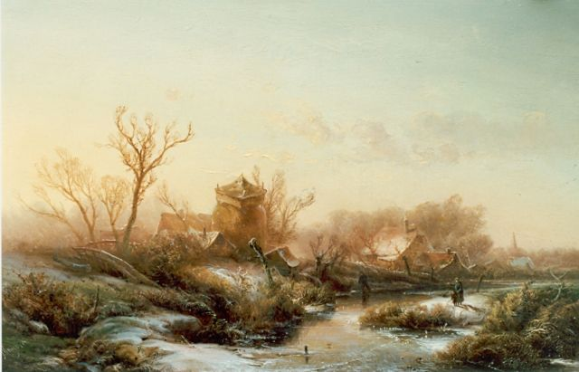 Pieter Kluyver | A snow-covered town, oil on panel, 27.2 x 43.3 cm, signed l.l.