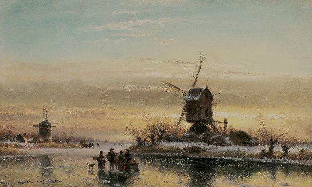 Lodewijk Johannes Kleijn | A frozen waterway with skaters and a windmill, oil on panel, 33.7 x 52.1 cm, signed l.l.