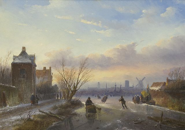 Jan Jacob Spohler | Skaters on a frozen river with a town in the distance, oil on panel, 30.5 x 43.0 cm, signed l.l.