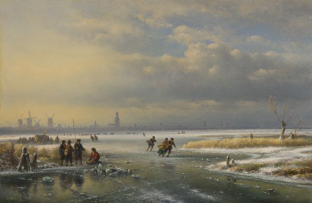 Lodewijk Johannes Kleijn | Skating on a frozen river near a town, oil on panel, 53.8 x 80.7 cm
