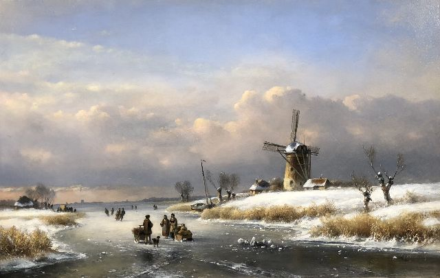 Lodewijk Johannes Kleijn | Winter landscape with a windmill and skaters, oil on panel, 33.6 x 52.0 cm, signed l.r.