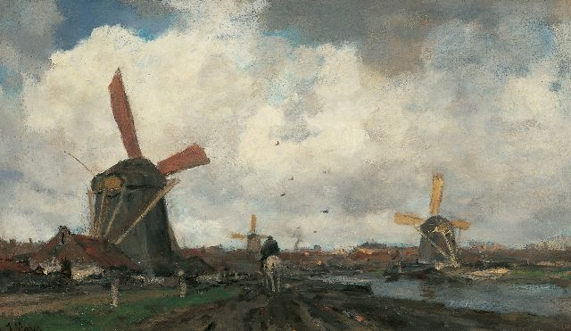 Jacob Maris | Windmills along a canal, oil on canvas, 38.3 x 64.9 cm, signed l.l.