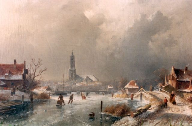 Charles Leickert | A winter landscape with skaters on the ice, Amersfoort in te distance, oil on canvas, 44.3 x 65.6 cm, signed l.l.