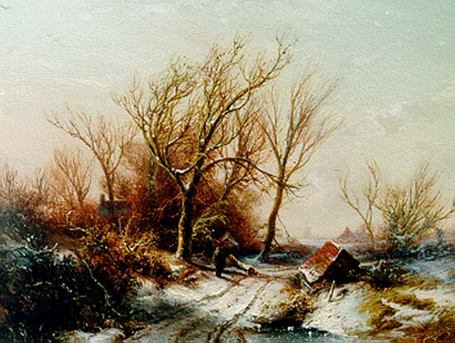Pieter Kluyver | A winter landscape with a traveller on a path, oil on panel, 23.3 x 30.8 cm, signed l.r.